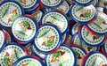 Belize Badges Background - Pile of Belizean Flag Buttons. Royalty Free Stock Photo