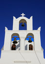 Bell cote on greek orthodox church in oia santorini with blue sky greece Royalty Free Stock Image