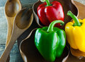 Bell pepper on a wooden dish background Royalty Free Stock Photography