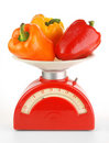 Bell peppers on scale Stock Photo