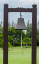 Bell with pillar wood. Royalty Free Stock Photo