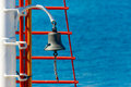Bell on sailing ship over the blue sea background Royalty Free Stock Images
