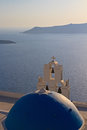 Bell tower above the sea in santorini of church beautiful blue bay at greece Stock Photography