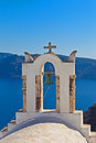 Bell tower above the sea in santorini of church beautiful blue bay at greece Stock Image