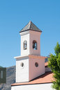 Bell tower of a church under blue sky Stock Photography