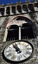 Bell tower and clock under the mullioned window in Ghivizzano in the province of Lucca, one of the beautiful and ancient medieval Royalty Free Stock Photo