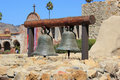 Bell tower at mission san juan capistrano two of the original bells sustained during the earthquake sit on display within the Stock Image