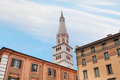 Bell tower of Modena Cathedral under urban houses Stock Image