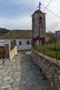 Bell Tower of Orthodox church with stone roof in village of Theologos, Thassos island, Greece Royalty Free Stock Photo