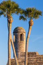 Bell tower and palms the on the san carlos bastion corner of the castillo de san marcos a seventeenth century spanish fortress in Stock Image