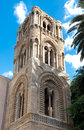Bell tower of renaissance church ornate stone marble work on a era in palermo sicily italy set against rich blue sky Stock Image