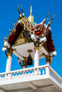 Bell tower on temple in thailand closeup of with blue sky background Stock Photo