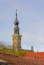 Bell tower of the town house above the roofs of Veere, the netherlands Royalty Free Stock Photo