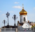 Bell tower and vintage street lights with golden cupola moscow city center Stock Photography