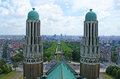 The bell towers brussels belgium june art deco of basilique du sacre coeur with modern city districts on background on Royalty Free Stock Photos
