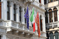 Bella Italia series. Flags in Venice. Italy. Royalty Free Stock Photo