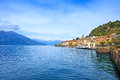 Bellagio town in como lake district landscape with marina and italian traditional lake village on background alps mountains Royalty Free Stock Photo