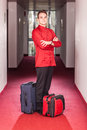 Bellboy with Luggages Stock Photography