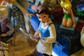 Belle figurine from beauty and the beast on a sophisticated toy comic board game and collection shop Stock Photography