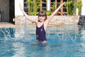 Belle fille dans la piscine Photo stock