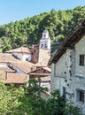 Bellfry of robledillo de gata belfry the spanish village cat surrounded by houses and trees is an image vertically on a sunny day Royalty Free Stock Photography