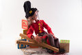 Bellhop marionette relaxing on a pile of blocks Royalty Free Stock Photos