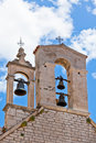 Bells on the croatian church tower with blue sky in background Stock Photography
