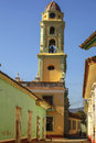 Belltower in trinidad cuba beautiful colonial church with along a cobblestone street Stock Photo
