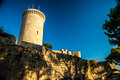 Bellver castle fortress in palma de mallorca the famous beautiful sunset light against blue sky spain travel destination Royalty Free Stock Photos