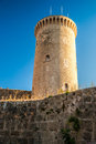 Bellver castle fortress in palma de mallorca the famous beautiful sunset light against blue sky spain travel destination Royalty Free Stock Photos