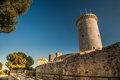 Bellver castle fortress in palma de mallorca the famous beautiful sunset light against blue sky spain travel destination Royalty Free Stock Photo