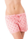 Belly of a beautiful woman with cute shorts on white background Stock Images