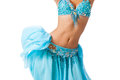 Belly dancer in a light blue costume shaking her hips Stock Photo