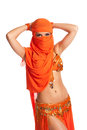 Belly dancer peeking from behind a bright orange veil Stock Photos