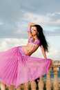 Belly Dancer in Pink Costume on Balustrade Royalty Free Stock Photo