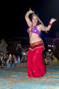 Belly dancer with sword a performs in desert dubai uae united arab emirates Royalty Free Stock Images