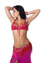 Belly dancer wearing a hot pink costume Stock Photography