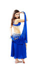 Belly dancer young beautiful girl in a blue costume Stock Photos