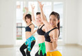 Belly exercising dancers performing together in the studio Stock Photos