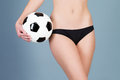 Belly with a soccer ball beautiful of woman hand holding Royalty Free Stock Image