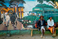 Belo sur tsiribihina elderly men sitting in front of a mural on sept in west of madagascar Royalty Free Stock Photo