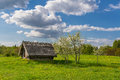 Belorussian country near minsk the old house trees sky and clouds spring Stock Images