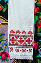 Belorussian embroidered towel with traditional ornaments on background rustic homespun carpet bright floral pattern Royalty Free Stock Photos