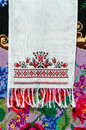 Belorussian towel with vintage ornament on the background of rustic homespun carpet bright floral pattern Stock Photography