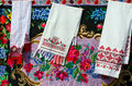 Belorussian towels with vintage ornament on the background of rustic homespun carpet bright floral pattern Stock Images