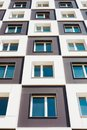 From below shot of modern and new apartment building. Photo of a tall block of flats against a sky. Royalty Free Stock Photo