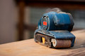 Belt sander on a wooden surface tool with saw dust Stock Image