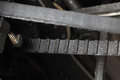 Belt transmission in a mechanical machine.