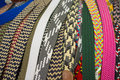 Belts assortment of woven texile on a street market stall Stock Photo