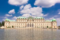 Belvedere palace is reflected in fountain wate water vienna austria Stock Photo
